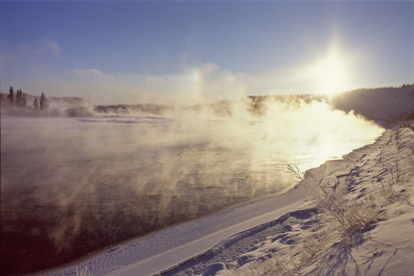 By Anthony DeLorenzo from Whitehorse, Yukon, Canada (Sun dogs and ice fog on the Yukon River) [CC BY 2.0 (http://creativecommons.org/licenses/by/2.0)], via Wikimedia Commons